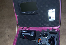 Base station with extra LCD screen, video goggles, video receiver, RC remote, and 12v battery for power